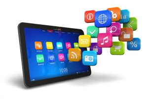 Tablet PC with cloud of colorful application icons isolated on white background